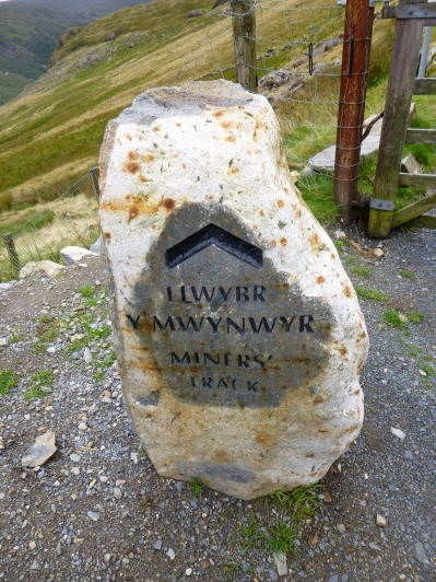 Miners Track sign stone